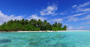 V02127 Maldives beautiful beach background white sandy tropical paradise island with blue sky sea water ocean 4k. Maldives beautiful beach background white sandy Royalty Free Stock Images