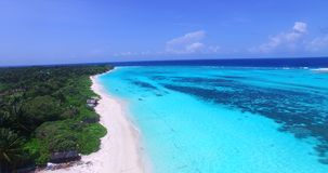 V00006 Maldives beautiful beach background white sandy tropical paradise island with blue sky sea water ocean 4k aerial stock video