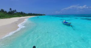 V00752 Maldives beautiful beach background white sandy tropical paradise island with blue sky sea water ocean 4k aerial stock video