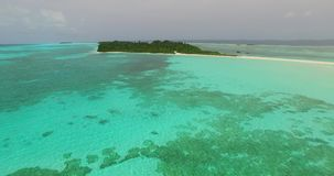 V00786 Maldives beautiful beach background white sandy tropical paradise island with blue sky sea water ocean 4k aerial stock footage