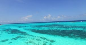 V00950 Maldives beautiful beach background white sandy tropical paradise island with blue sky sea water ocean 4k aerial stock video footage