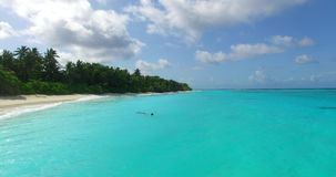 V00008 Maldives beautiful beach background white sandy tropical paradise island with blue sky sea water ocean 4k aerial stock footage