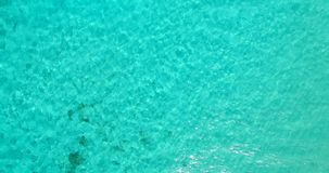 V00058 Maldives beautiful beach background white sandy tropical paradise island with blue sky sea water ocean 4k aerial stock video footage