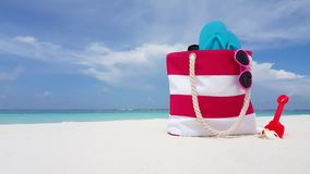 V02121 Maldives beautiful beach background white sandy tropical paradise island with blue sky sea water ocean 4k bag. Maldives beautiful beach background white stock footage