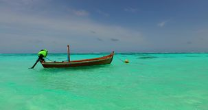 V02304 Maldives beautiful beach background white sandy tropical paradise island with blue sky sea water ocean 4k boat stock footage
