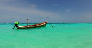 V02304 Maldives beautiful beach background white sandy tropical paradise island with blue sky sea water ocean 4k boat Royalty Free Stock Photo