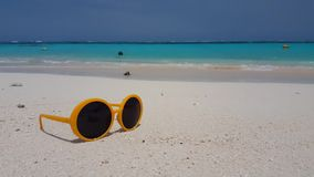 V00861 Maldives beautiful beach background white sandy tropical paradise island with blue sky sea water ocean 4k yellow stock footage