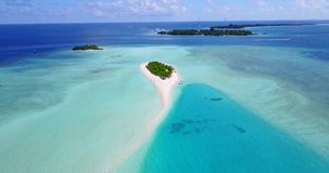 V08925 maldives tropical island and blue sea with drone aerial flying view on a beach with white sand and beautiful sky. Maldives tropical island and blue sea stock footage