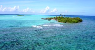V08907 maldives tropical island and blue sea with drone aerial flying view on a beach with white sand and beautiful sky. Maldives tropical island and blue sea stock video