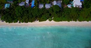 V08671 maldives tropical island and blue sea with drone aerial flying view on a beach with white sand and beautiful sky. Maldives tropical island and blue sea stock footage