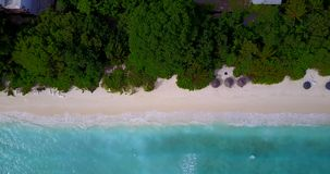 V08993 maldives tropical island and blue sea with drone aerial flying view on a beach with white sand and beautiful sky. Maldives tropical island and blue sea stock footage