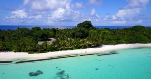 V08703 maldives tropical island and blue sea with drone aerial flying view on a beach with white sand and beautiful sky. Maldives tropical island and blue sea stock footage