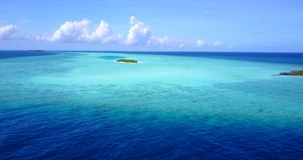 V08641 maldives tropical island and blue sea with drone aerial flying view on a beach with white sand and beautiful sky. Maldives tropical island and blue sea stock video