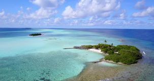 V08826 maldives tropical island and blue sea with drone aerial flying view on a beach with white sand and beautiful sky. Maldives tropical island and blue sea stock footage