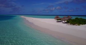 V08619 maldives tropical island and blue sea with drone aerial flying view on a beach with white sand and beautiful sky. Maldives tropical island and blue sea stock footage