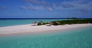 V08978 maldives tropical island and blue sea with drone aerial flying view on a beach with white sand and beautiful sky. Maldives tropical island and blue sea stock video