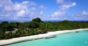 V08696 maldives tropical island and blue sea with drone aerial flying view on a beach with white sand and beautiful sky. Maldives tropical island and blue sea stock video footage