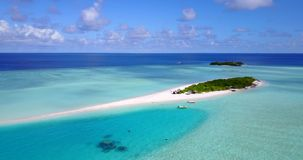 V08864 maldives tropical island and blue sea with drone aerial flying view on a beach with white sand and beautiful sky. Maldives tropical island and blue sea stock video
