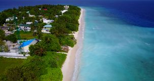 V08770 maldives tropical island and blue sea with drone aerial flying view on a beach with white sand and beautiful sky. Maldives tropical island and blue sea stock video footage