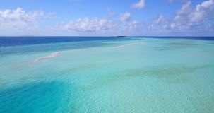 V08912 maldives tropical island and blue sea with drone aerial flying view on a beach with white sand and beautiful sky. Maldives tropical island and blue sea stock video