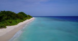 V08827 maldives tropical island and blue sea with drone aerial flying view on a beach with white sand and beautiful sky. Maldives tropical island and blue sea stock video