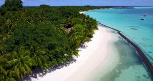 V08634 maldives tropical island and blue sea with drone aerial flying view on a beach with white sand and beautiful sky. Maldives tropical island and blue sea stock video