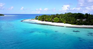 V08643 maldives tropical island and blue sea with drone aerial flying view on a beach with white sand and beautiful sky. Maldives tropical island and blue sea stock video footage