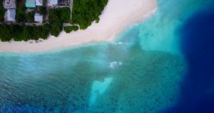 V08737 maldives tropical island and blue sea with drone aerial flying view on a beach with white sand and beautiful sky stock video