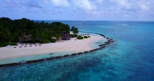 V08788 maldives tropical island and blue sea with drone aerial flying view on a beach with white sand and beautiful sky stock footage