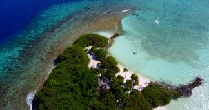V15438 maldives white sand beach tropical islands with drone aerial flying birds eye view with aqua blue sea water and stock footage