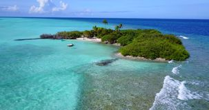 V14511 maldives white sand beach tropical islands with drone aerial flying birds eye view with aqua blue sea water and Stock Photos