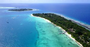 V14752 maldives white sand beach tropical islands with drone aerial flying birds eye view with aqua blue sea water and Stock Photography