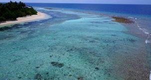 V14560 maldives white sand beach tropical islands with drone aerial flying birds eye view with aqua blue sea water and Stock Images