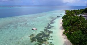 V11682 maldives white sand beach tropical islands with drone aerial flying birds eye view with aqua blue sea water and Stock Image