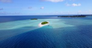 V14690 maldives white sand beach tropical islands with drone aerial flying birds eye view with aqua blue sea water and Royalty Free Stock Photos