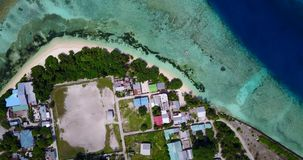 V14649 maldives white sand beach tropical islands with drone aerial flying birds eye view with aqua blue sea water and Stock Photos