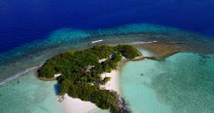 V15077 maldives white sand beach tropical islands with drone aerial flying birds eye view with aqua blue sea water and Royalty Free Stock Photo