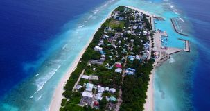 V11497 maldives white sand beach tropical islands with drone aerial flying birds eye view with aqua blue sea water and Royalty Free Stock Image