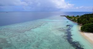 V11752 maldives white sand beach tropical islands with drone aerial flying birds eye view with aqua blue sea water and Stock Image