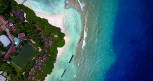 V11409 maldives white sand beach tropical islands with drone aerial flying birds eye view with aqua blue sea water and Royalty Free Stock Image