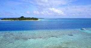 V14793 maldives white sand beach tropical islands with drone aerial flying birds eye view with aqua blue sea water and Stock Images