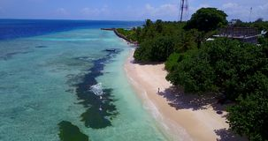 V14608 maldives white sand beach tropical islands with drone aerial flying birds eye view with aqua blue sea water and Royalty Free Stock Photo
