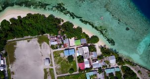 V14670 maldives white sand beach tropical islands with drone aerial flying birds eye view with aqua blue sea water and Royalty Free Stock Image
