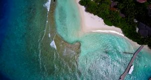 V11768 maldives white sand beach tropical islands with drone aerial flying birds eye view with aqua blue sea water and Stock Photography