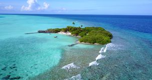 V14486 maldives white sand beach tropical islands with drone aerial flying birds eye view with aqua blue sea water and Stock Photo