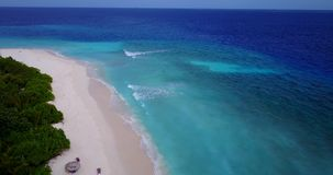 V14775 maldives white sand beach tropical islands with drone aerial flying birds eye view with aqua blue sea water and Stock Image