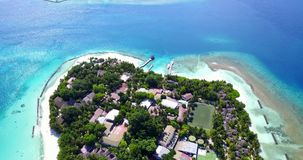 V10361 maldives white sand beach tropical islands with drone aerial flying view with aqua blue sea water and sunny sky Stock Photos