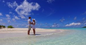 V07381 Maldives white sandy beach 2 people young couple man woman proposal engagement wedding marriage on sunny tropical Stock Photos