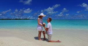 V07387 Maldives white sandy beach 2 people young couple man woman proposal engagement wedding marriage on sunny tropical Royalty Free Stock Image