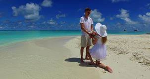 V07383 Maldives white sandy beach 2 people young couple man woman proposal engagement wedding marriage on sunny tropical Stock Photos